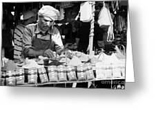 Local Arab Man Measuring Out A Quantity Of Spice For Sale On Stall Of Spices At The Market In Nabeul Tunisia Greeting Card by Joe Fox