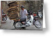 Man Carrying Cardboard On The Back Of His Scooter Greeting Card by Sami Sarkis