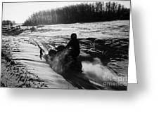 man on snowmobile crossing frozen fields in rural Forget canada Greeting Card by Joe Fox