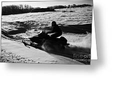 man on snowmobile crossing frozen fields in rural Forget Saskatchewan Greeting Card by Joe Fox