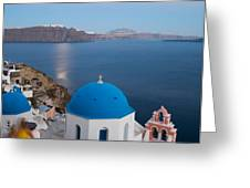 Moon over blue domed church in Oia Santorini Greece Greeting Card by Matteo Colombo