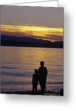 Mother And Daughter Holding Each Other Along Edmonds Beach At Su Greeting Card by Jim Corwin