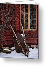 Old Wheelbarrow Leaning Against Barn In Winter Greeting Card by Sandra Cunningham