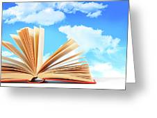 Open Book Against A Blue Sky Greeting Card by Sandra Cunningham