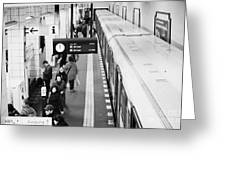passengers along ubahn train platform Friedrichstrasse Friedrichstrasse u-bahn station Berlin Greeting Card by Joe Fox