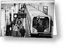 passengers on ubahn train platform as train leaves Friedrichstrasse u-bahn station Berlin Germany Greeting Card by Joe Fox