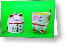 Playing Golf On Cat Cups Greeting Card by Paul Ge
