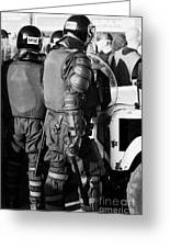 Psni Officer In Riot Gear With Shield And Baton On Crumlin Road At Ardoyne Shops Belfast 12th July Greeting Card by Joe Fox