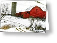 Red Barn In Snow Greeting Card by John Haldane