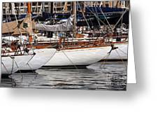 Sailboat Hulls In The Port Greeting Card by John Rizzuto