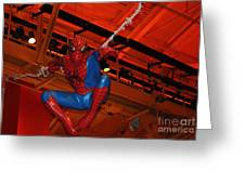 Spiderman Swinging Through The Air Greeting Card by John Telfer