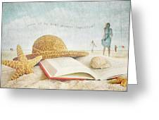 Straw Hat And Book In The Sand Greeting Card by Sandra Cunningham