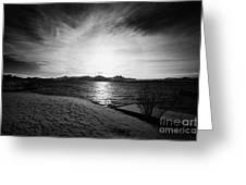 sun setting with halo over snow covered telegrafbukta beach Tromso troms Norway europe Greeting Card by Joe Fox
