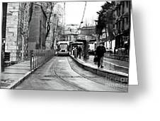 Waiting For The Tram In Istanbul Greeting Card by John Rizzuto