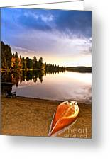Lake Sunset With Canoe On Beach Greeting Card by Elena Elisseeva