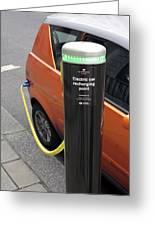 Recharging An Electric Car Greeting Card by Martin Bond