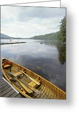 A Canoe Floats Next To A Dock Greeting Card by Skip Brown