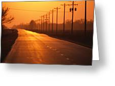 A Country Highway Fades Into The Sunset Greeting Card by Joel Sartore
