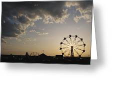 A Ferris Wheel Is Silhouetted Greeting Card by Stephen Alvarez