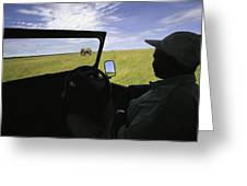A Guide In A Jeep Observing An African Greeting Card by Michael Melford