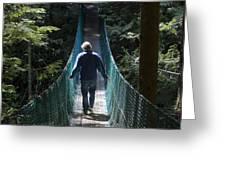 A Man Walks Across A Suspension Bridge Greeting Card by Taylor S. Kennedy