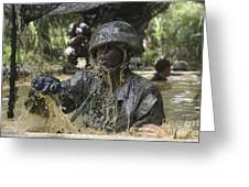 A Marine Splashes As He Makes His Way Greeting Card by Stocktrek Images