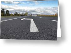 A Metalled Road With A Large Greeting Card by Jaak Nilson