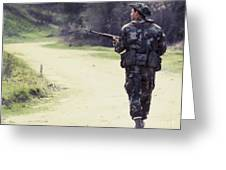 A Navy Seal Patrols Down The Road Greeting Card by Michael Wood