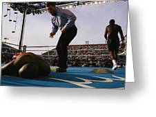 A Referee Counts Out A Fallen Boxer Greeting Card by Maria Stenzel