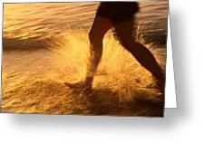 A Runner Splashing Through The Surf Greeting Card by Phil Schermeister