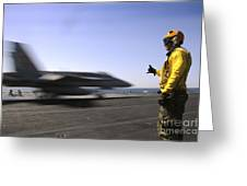 A Sailor Ensures An Fa-18c Hornet Greeting Card by Stocktrek Images