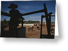 A Silhouetted Cowboy Watches Riders Greeting Card by Raul Touzon