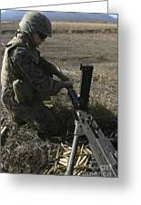 A Soldier Changes The Barrel Of An M2 Greeting Card by Stocktrek Images