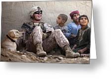 A U.s. Marine Jokes With Afghan Greeting Card by Stocktrek Images