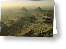 Aerial View Of The Pyramids Of Giza Greeting Card by Kenneth Garrett