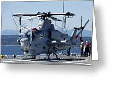 An Ah-1w Cobra Is Chained To The Flight Greeting Card by Stocktrek Images