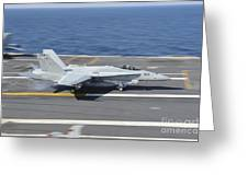 An Fa-18c Hornet Lands Aboard Uss Greeting Card by Stocktrek Images