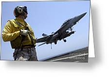 An Officer Observes An Fa-18f Super Greeting Card by Stocktrek Images