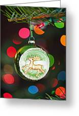 An Ornament With A Reindeer Hanging Greeting Card by Craig Tuttle
