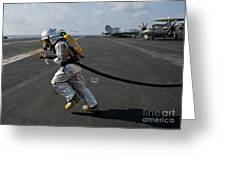 Aviation Boatswain's Mate Carries Greeting Card by Stocktrek Images