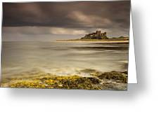 Bamburgh Castle Under A Cloudy Sky Greeting Card by John Short