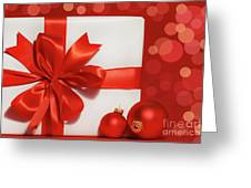 Big Red Bow On Gift  Greeting Card by Sandra Cunningham