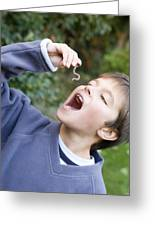 Boy Pretending To Eat An Earthworm Greeting Card by Ian Boddy