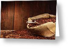 Burlap Sack Of Coffee Beans Against Dark Wood Greeting Card by Sandra Cunningham