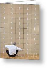 Businessman Seated Facing Cardboard Boxes Wall Greeting Card by Sami Sarkis