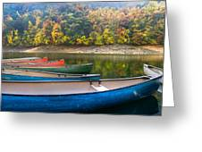 Canoes At Fontana Greeting Card by Debra and Dave Vanderlaan
