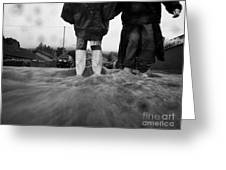 children walking in heavy rain storm in the street Greeting Card by Joe Fox