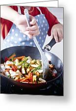 Cooking A Stir Fry Greeting Card by Veronique Leplat
