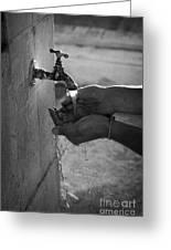 Hispanic Man Cupping Water And Washing Hands At Outdoor Tap Greeting Card by Joe Fox