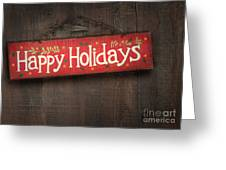 Holiday sign on distressed wood wall Greeting Card by Sandra Cunningham